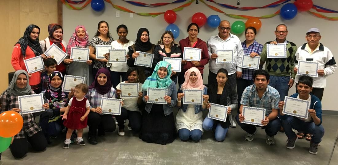 Recent Dallas ESL graduates show off their certificates!