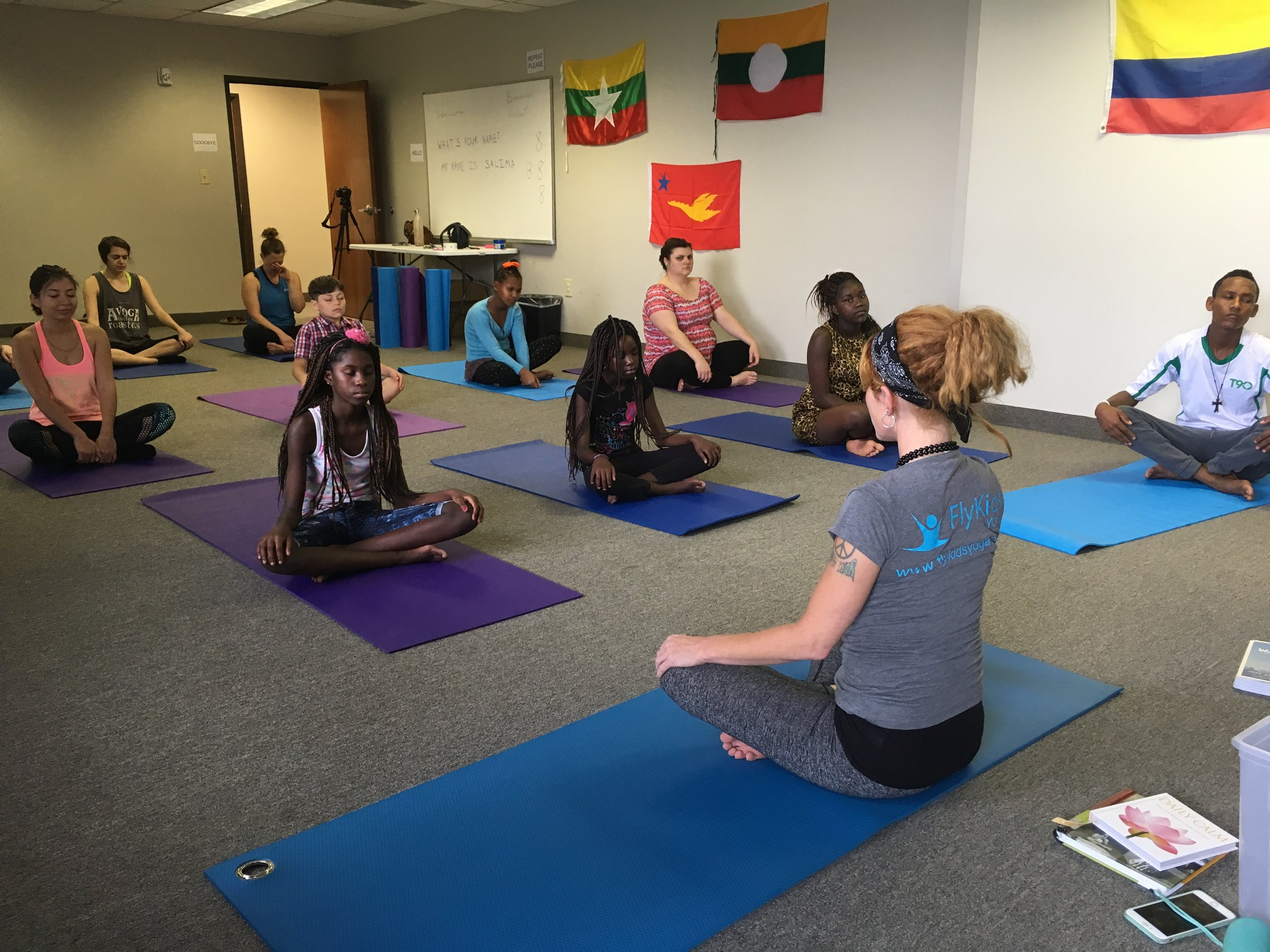FlyKids Yoga instructor working with RST clients