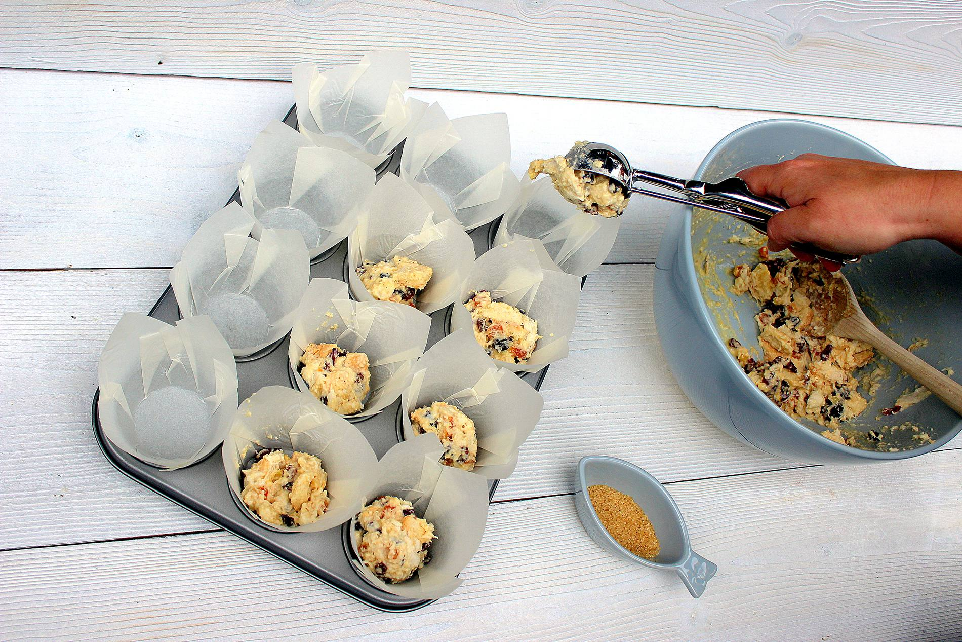 Scoop into muffin cases, top with sugar