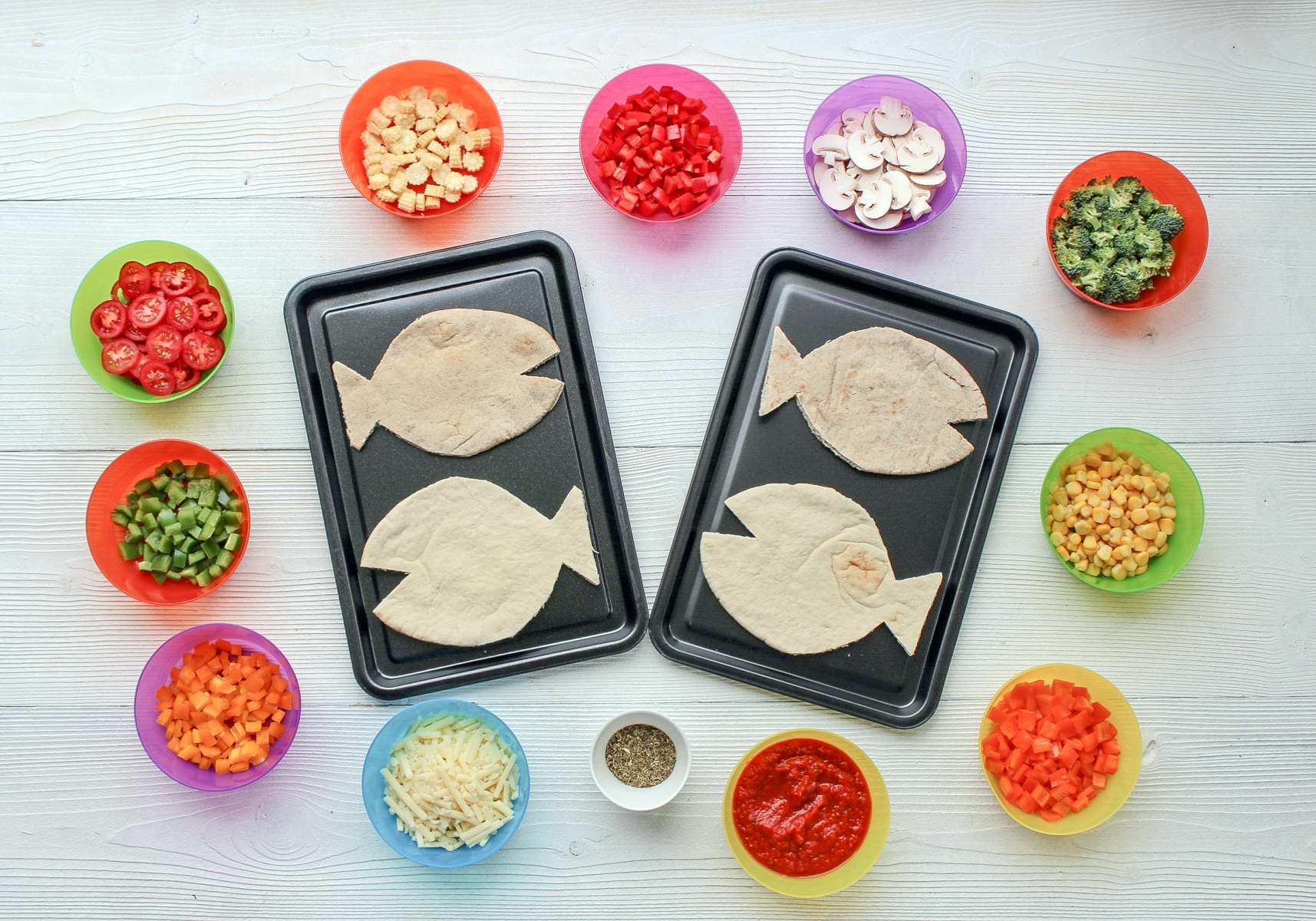 Carefully trim pitta into fish shapes