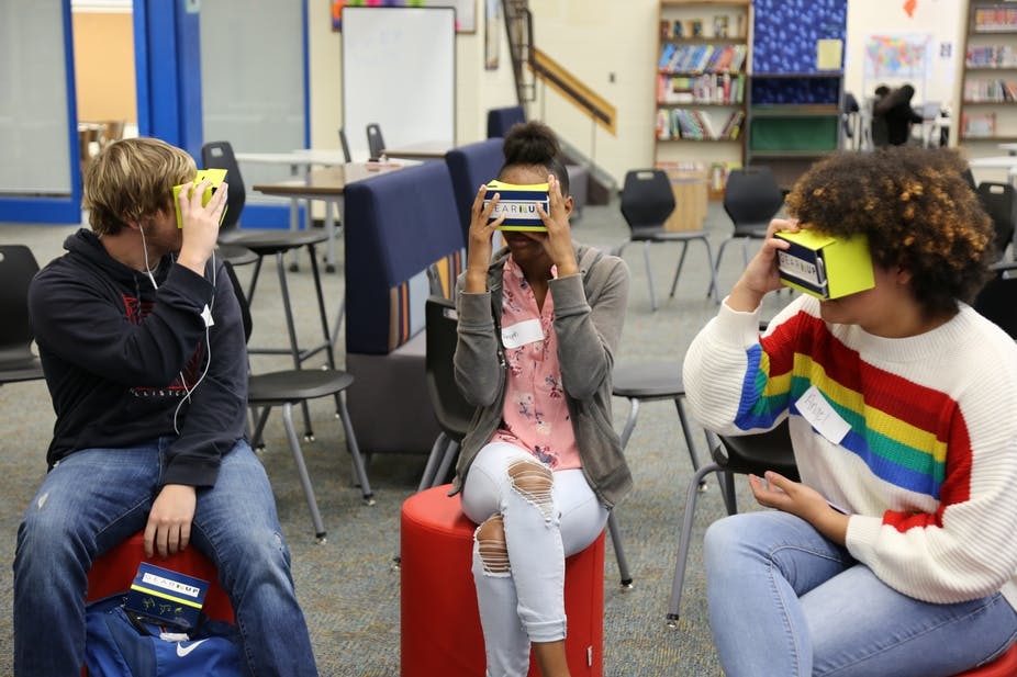 Students at Person High School use cardboard goggles to take a virtual tour of University of North Carolina campuses. (Person County Schools)
