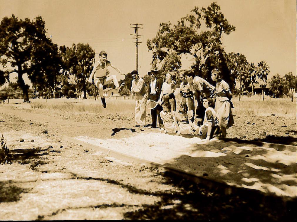 "Image ""longjump"": Vasco Sardi doing the long jump in 1938 at a school playground"