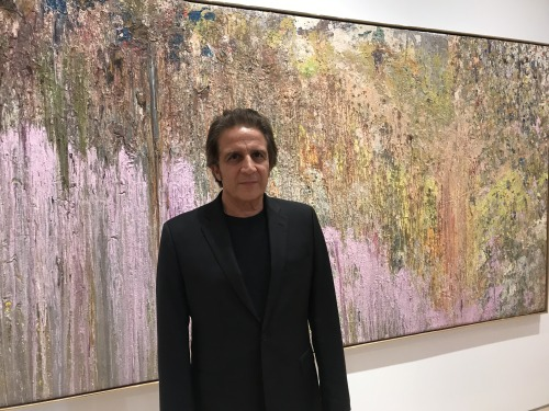 "Dennis Yares in front of Larry Poons'  ""Tantrum II""  (1979, acrylic on canvas) at Yares Art, New York."
