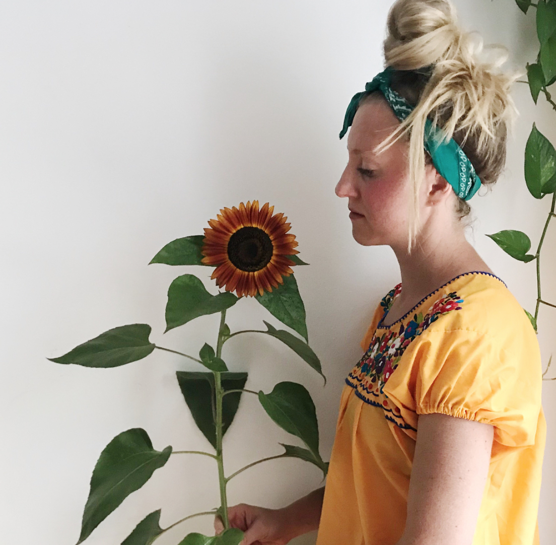 Me, with a sunflower I grew from my fire escape garden
