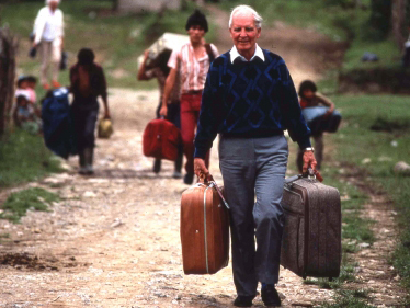 Dr. Leeon Aller, founder of HFPF, carrying suitcases of medicine for a stay in Barillas.