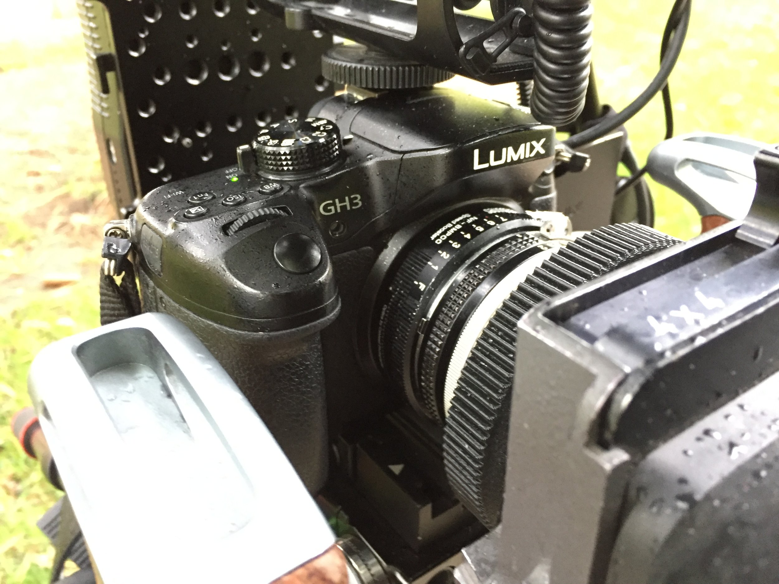 A shot of the camera rig mid-production in the rain. We shot on the Panasonic GH3 and Nikon D7000. The lens was an old Nikkor 24 1.4mm prime + speed booster. In addition, an Arri matte box.