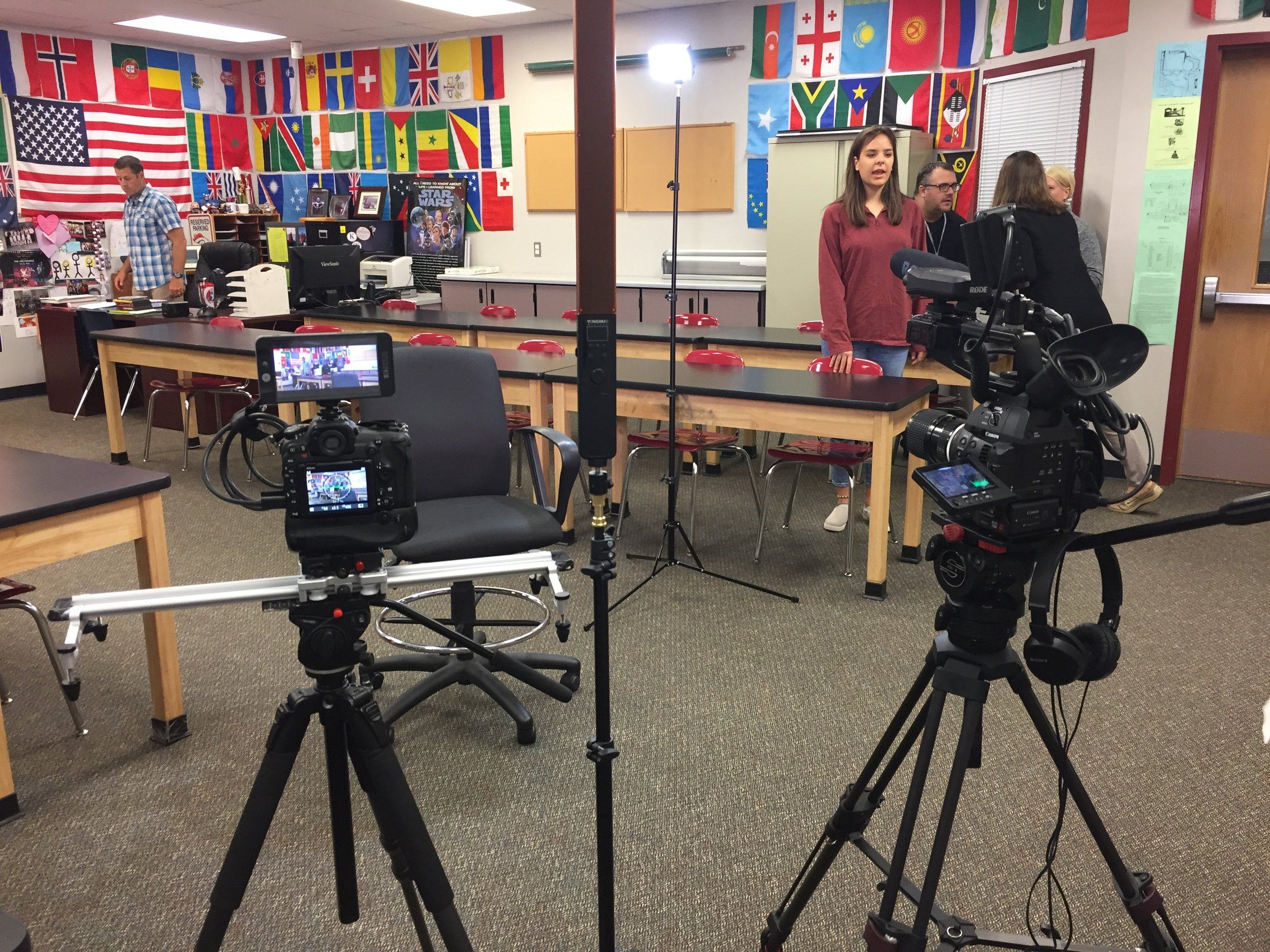 Setting up for the first interview of Day 2. We were to interview a High School teacher (back left). His class was sitting just off camera (left of the screen) while he conducted the interview.