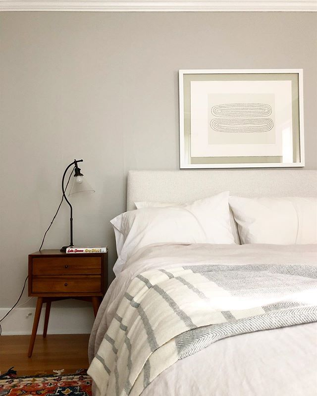 Not ready to tackle a full closet organization overhaul? Start with the area immediately surrounding your bed - it's the first thing you'll see when you wake up. Here we tidied up the nightstand and hung some art 🖼 for a quick refresh.