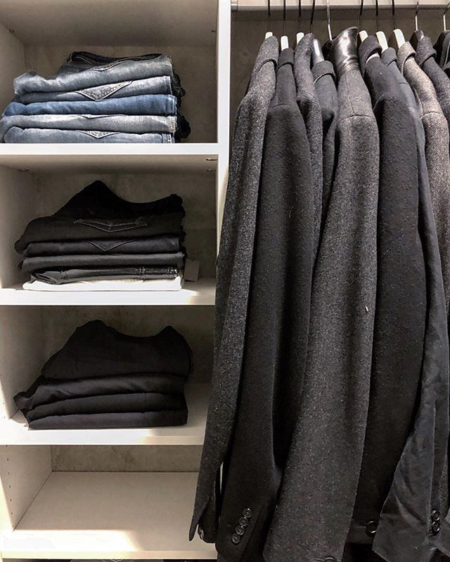 Happy Friday Superfiners! Here's a corner shot of our favorite closet we organized this week. Floor-to-ceiling shelving made for plenty of storage options, and the monochromatic wardrobe is oh so easy on the eyes.