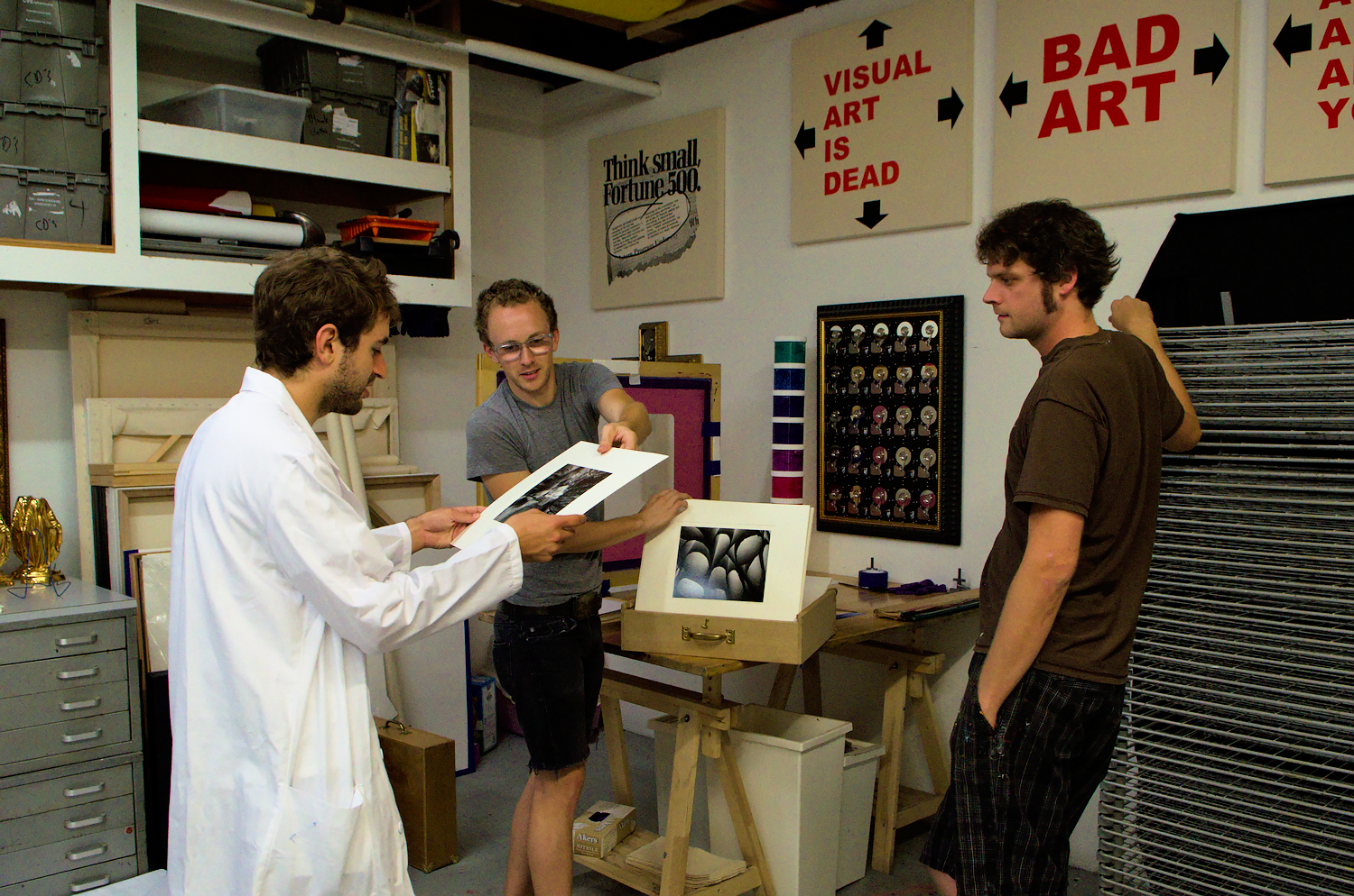 "Daniel Rolnik (left) and Ryan McIntosh (middle) founded a new silkscreen studio in january 2013 called ""Intellectual Property Prints"". They propose artists who are unfamiliar with printmaking techniques to assist them in editing their work."