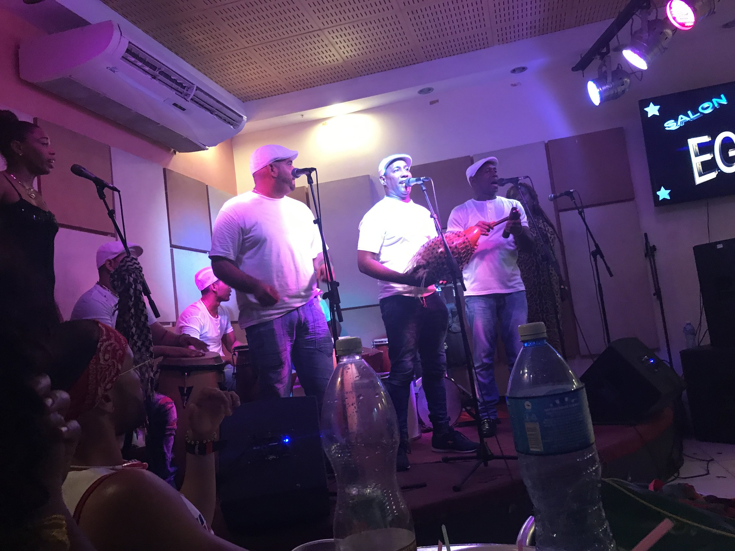 Top 5 Reasons to Visit Cuba - 5. Cool cars4. Spanish architecture3. Afro-Cuban culture2. Rumba and salsa1. Revolutionary historyImage: A rumba live performance at a club in Old Havana