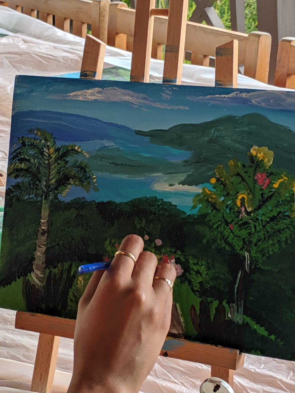 A Point of View guest paints the view from the verandah during a Coffee and Canvas with Dee