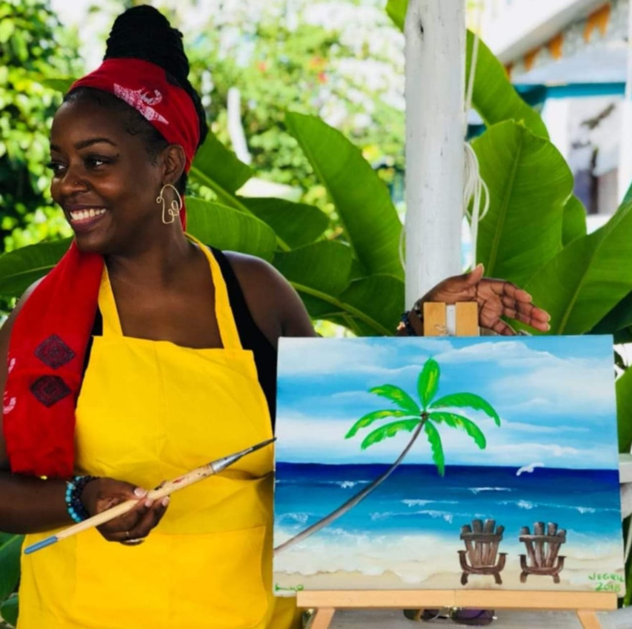 Dee teaches a painting class in Jamaica