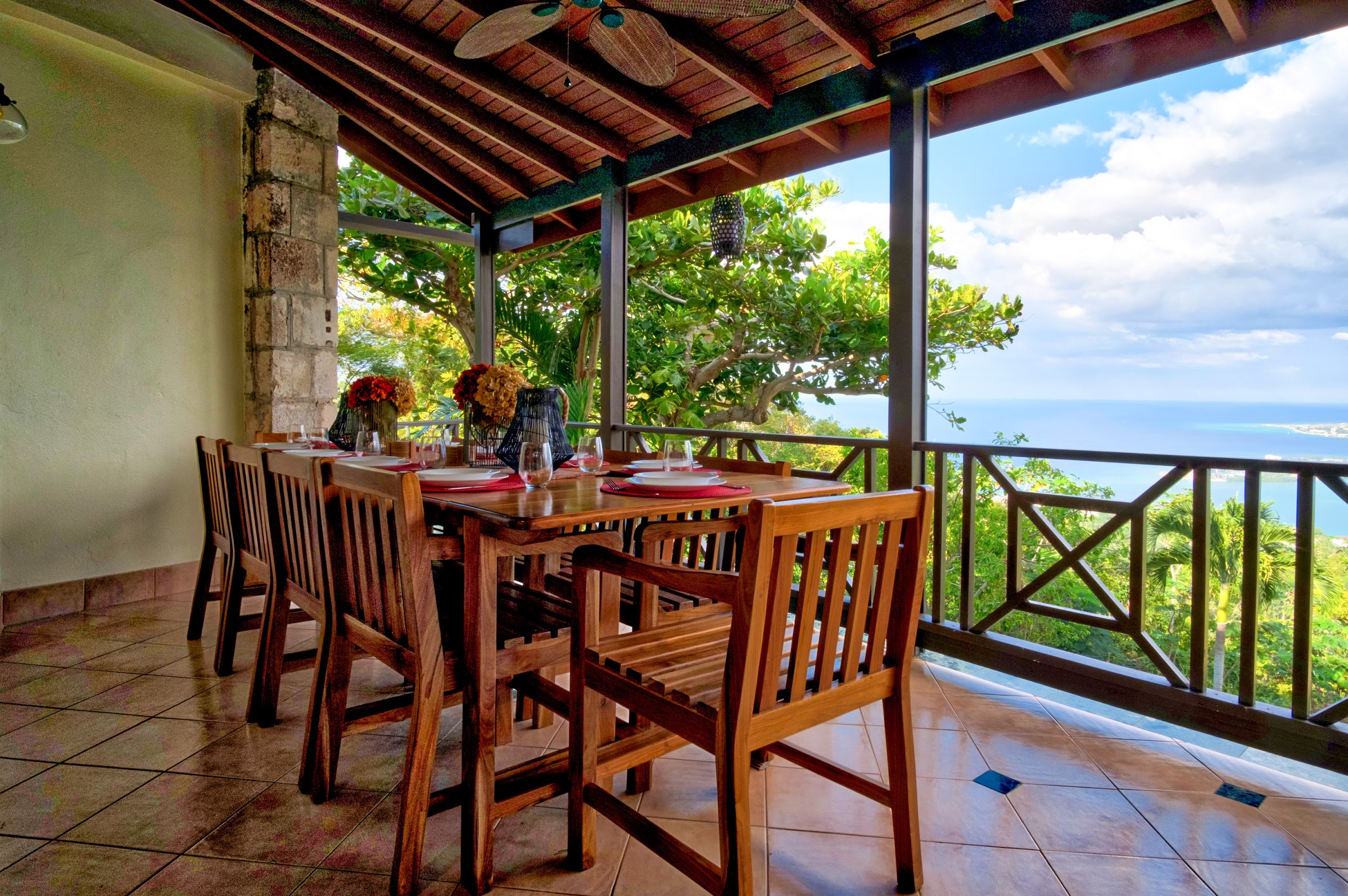 After shot of the verandah with a locally made teak dining table with seating for 10 (still facing Montego Bay)!