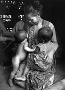 Source Unknown wet nursing tandem breastfeeding.jpg