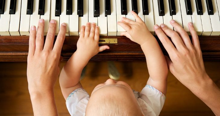 Baby-Playing-Piano-With-Mother-1.jpg