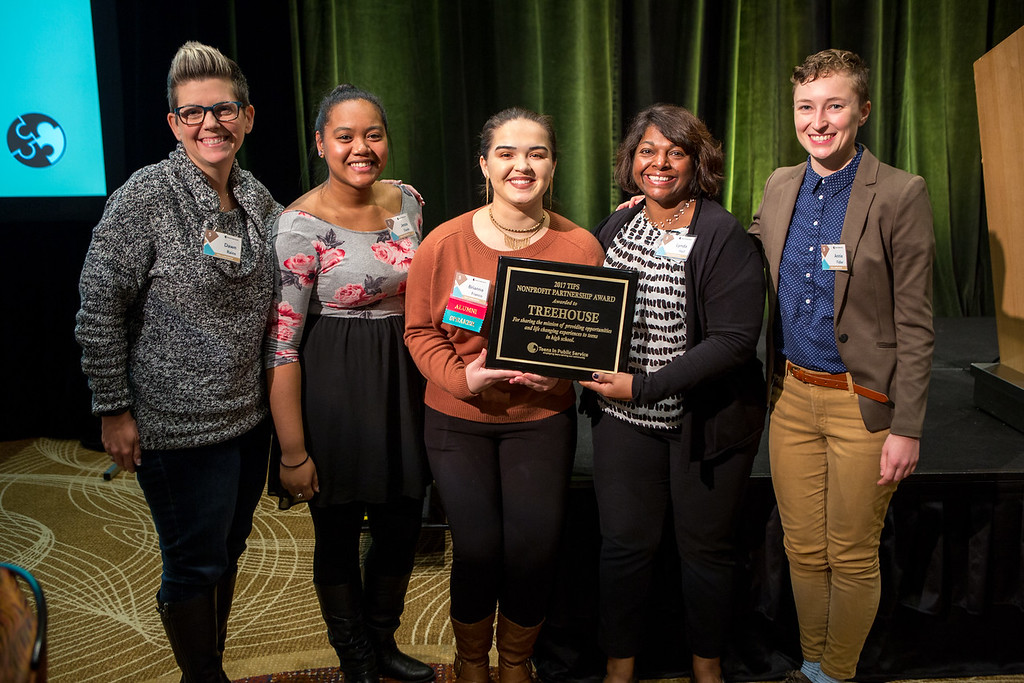 Nonprofit Partner Award recipients from Treehouse with TIPS Intern Alumna Brianna Franco (middle)