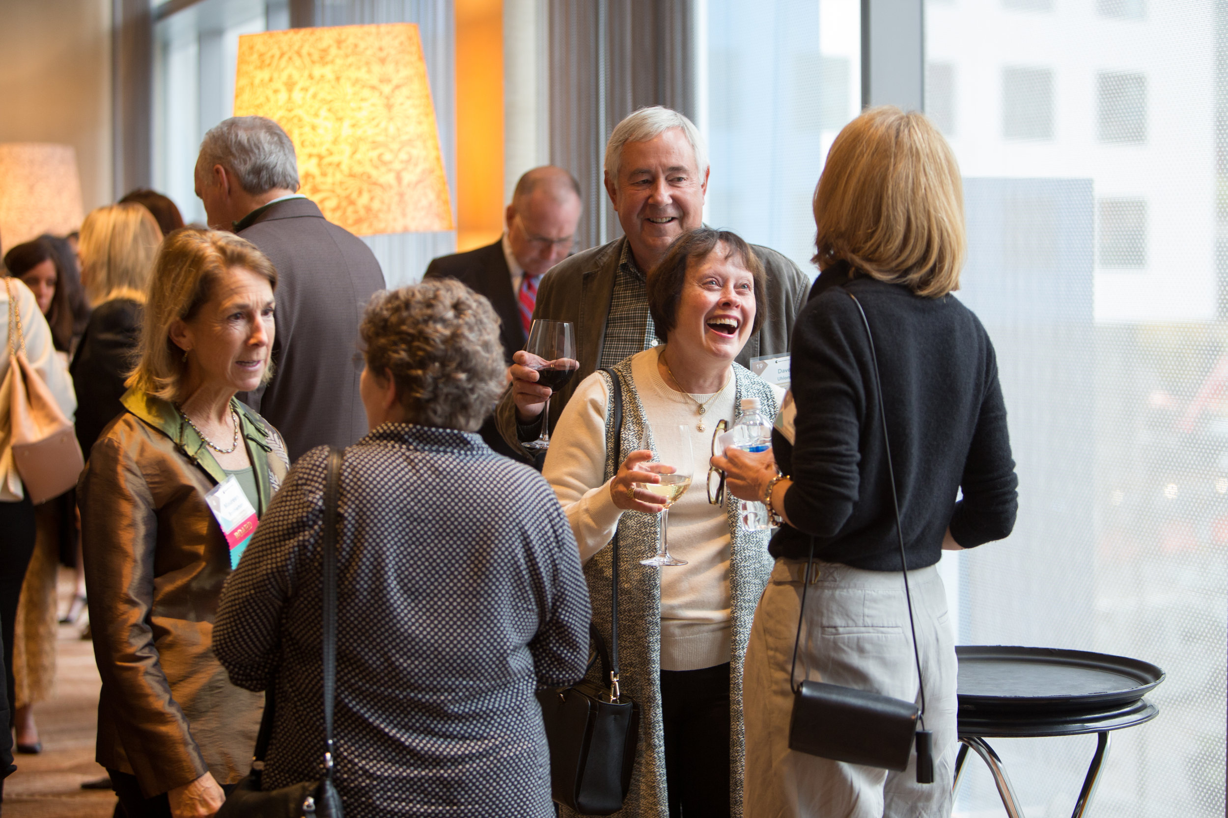 TIPS Co-Founder Maureen Brotherton (far left) enjoys a moment with guests