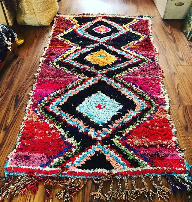 "This 1980's Boucherouite is in the shop and measures 42""x82"". Use it on your floor, throw in over your couch, or layer it wherever you need some color. #boucherouite #vintagerugs #morrocanrugs"