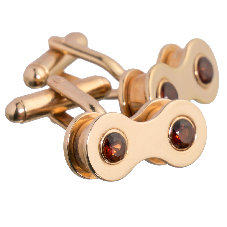 Rose gold cufflinks with garnet
