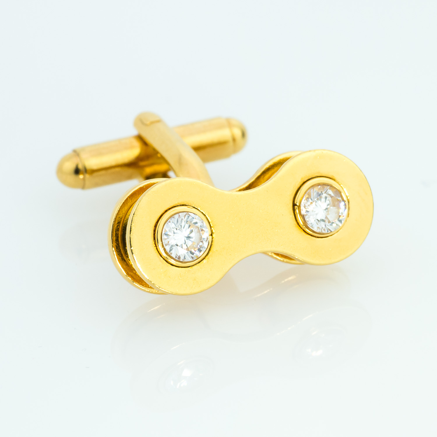 Gold and created diamond cufflinks. Made from bike chain.