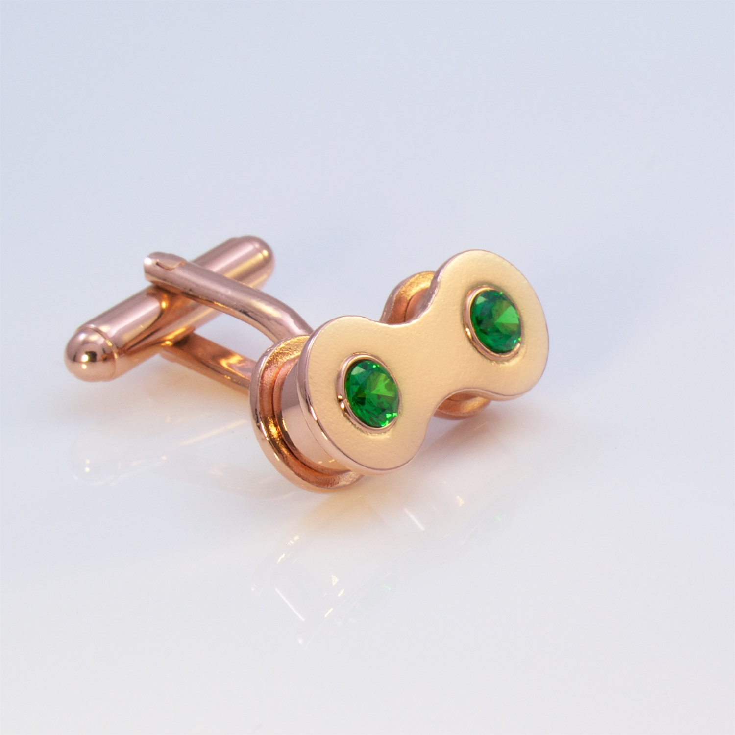 Rose gold cufflink with created emerald
