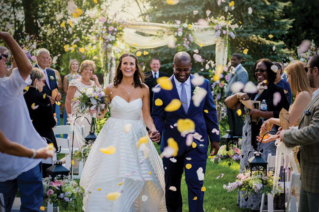 Jen + Darrell - The bride's family horse farm was the perfect setting for this couple's outdoor wedding. The bride and groom made sure their guests had a fun-filled evening with dancing, yard games, and fireworks.