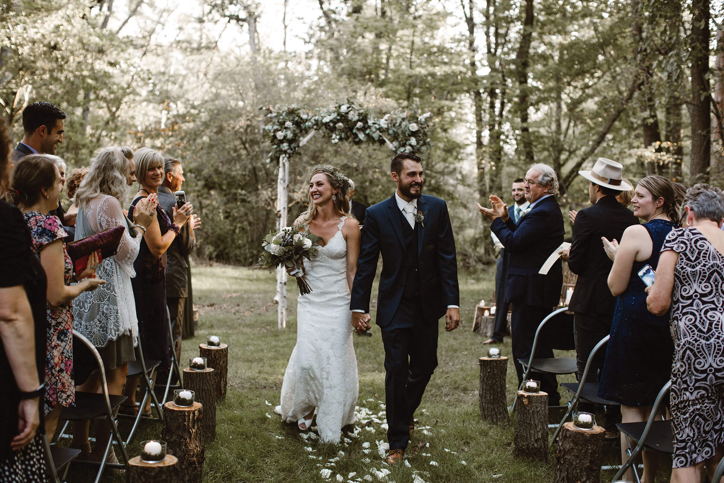Adrienne + Britton - An enchanted wedding under a canopy of tall pine trees full of greenery, succulents, flowers and glowing candles is purely mystical.