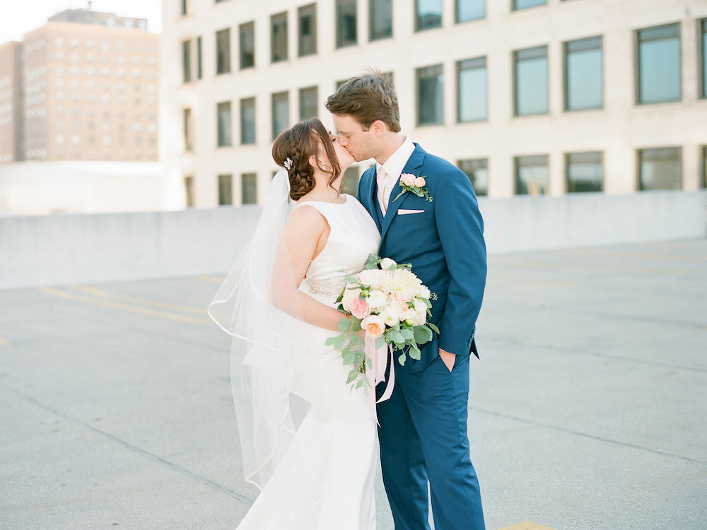 Kristen + Kyle - This sweet and elegant wedding in downtown Toledo features a beautiful marriage braid ceremony.