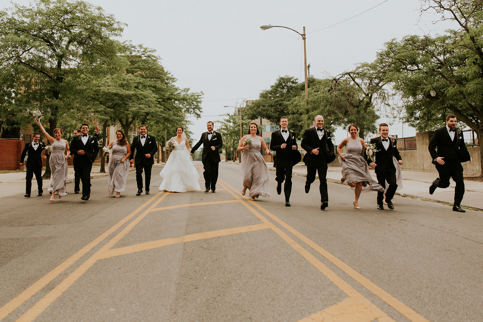Amy + Dylan - When the wedding party is up for running down the streets of Toledo, they are people you want to party with!