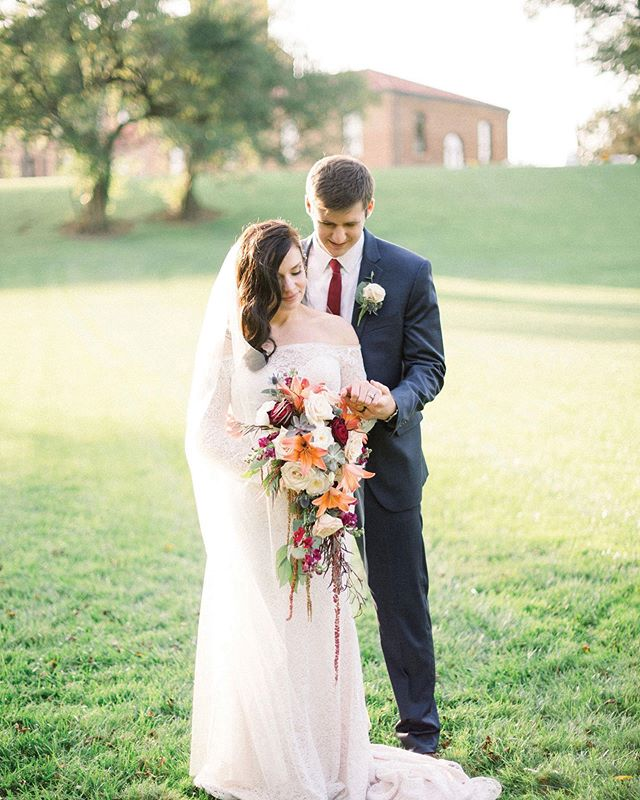 With fall just around the corner, we are loving the rich hues from this October wedding. photography // @timandkylee . . #toledowedding #ohiowedding #toledoweddingguide #toledoohio #toledobride #ohiobride #fallwedding #weddingdress #weddingflowers #rusticwedding