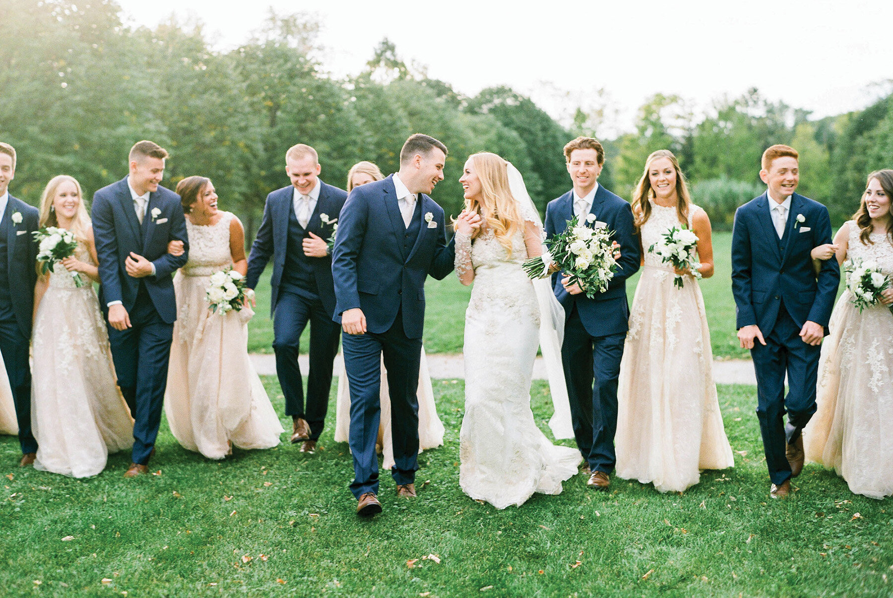 Megan + Nick - We can't decide if we love the bride's gown or the bridesmaids dresses more.