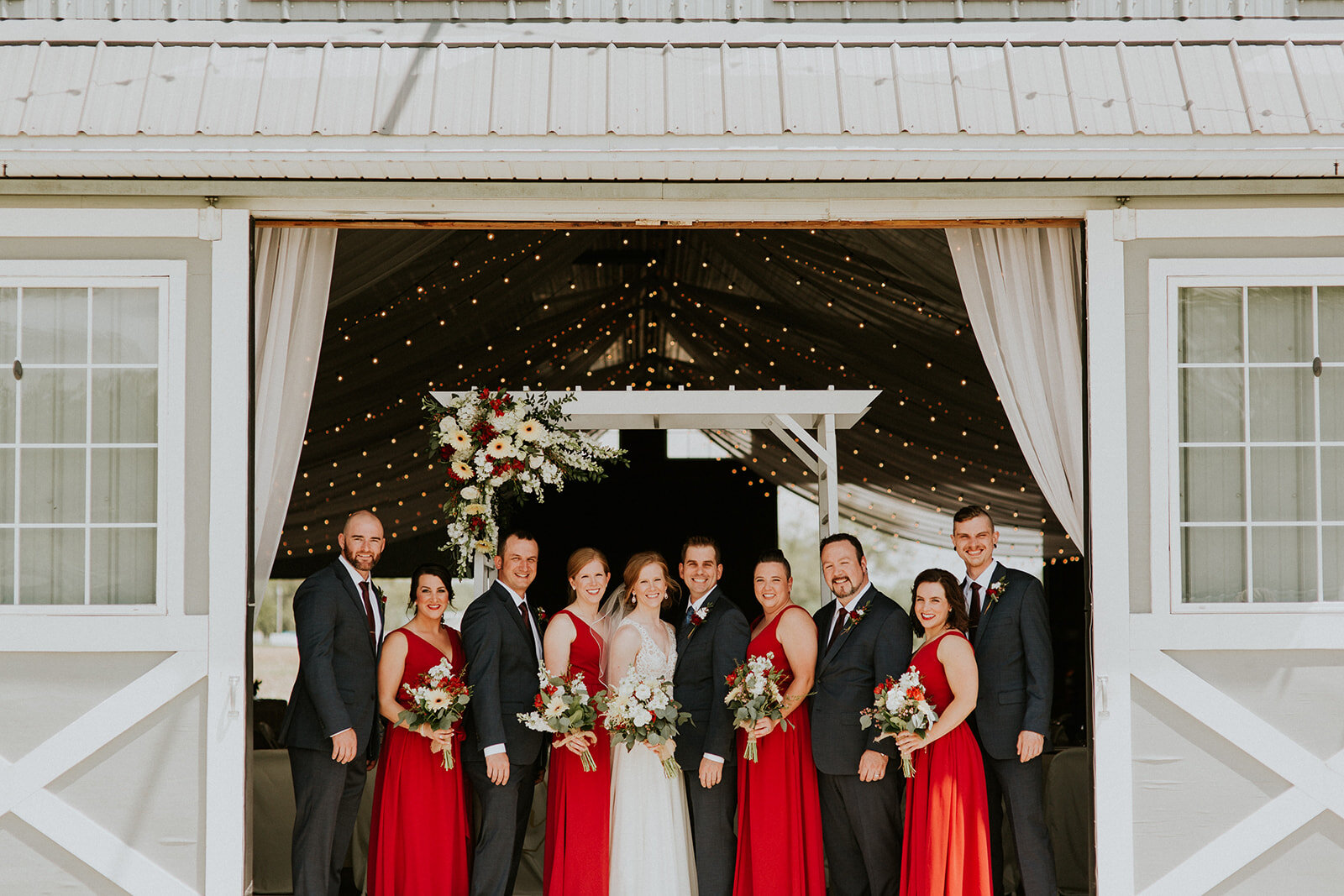 Heather + Ryan - From rustic elements to lush greenery to vibrant red details this wedding at The Stables tied together perfectly.