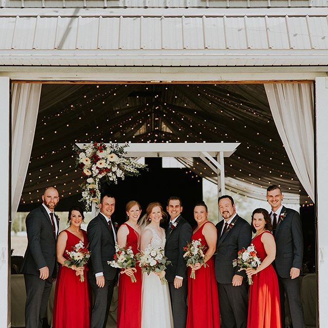 From rustic elements to lush greenery to vibrant red details this wedding at The Stables tied together perfectly. photography // @adoreweddingphotography  wedding coordination // @beefortheday  ceremony + reception venue // @thestablesonobee  bridal gown // @thegownshopbridal . . #toledoweddingguide #toledowedding #ohiowedding #toledobride #ohiobride #toledolove #rusticwedding #redwedding #weddingflorals #weddinglove #brideandgroom #bridesmaids