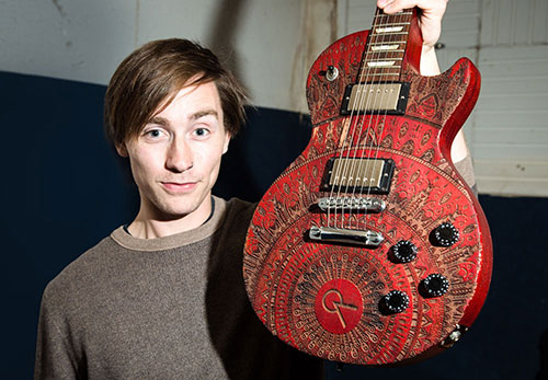 Testimonals James Macdonald of City of Ashes with his laser etched burntaxe customised guitar in red