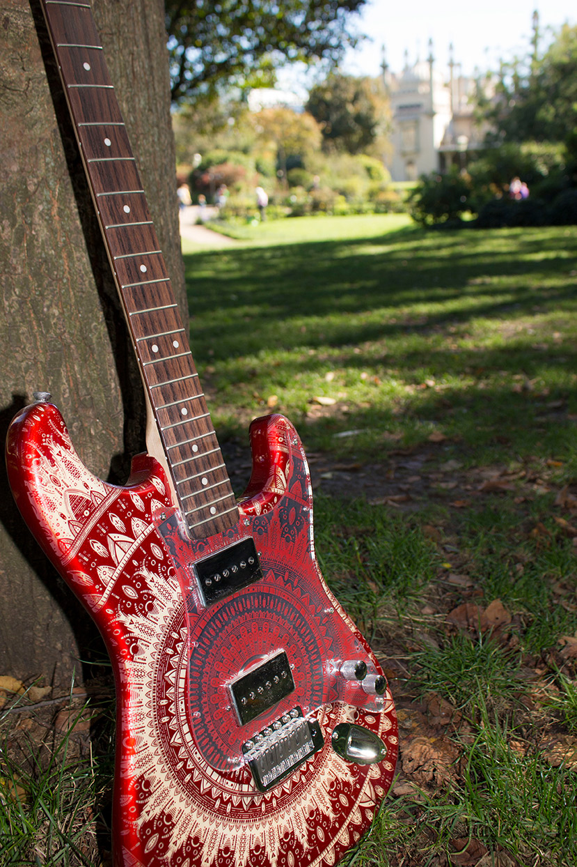 Burntaxe Red Mindy Stratocaster with Mandala etch and mirrored red scratchplate resting by the Brighton Pavilion on the first day of Autumn