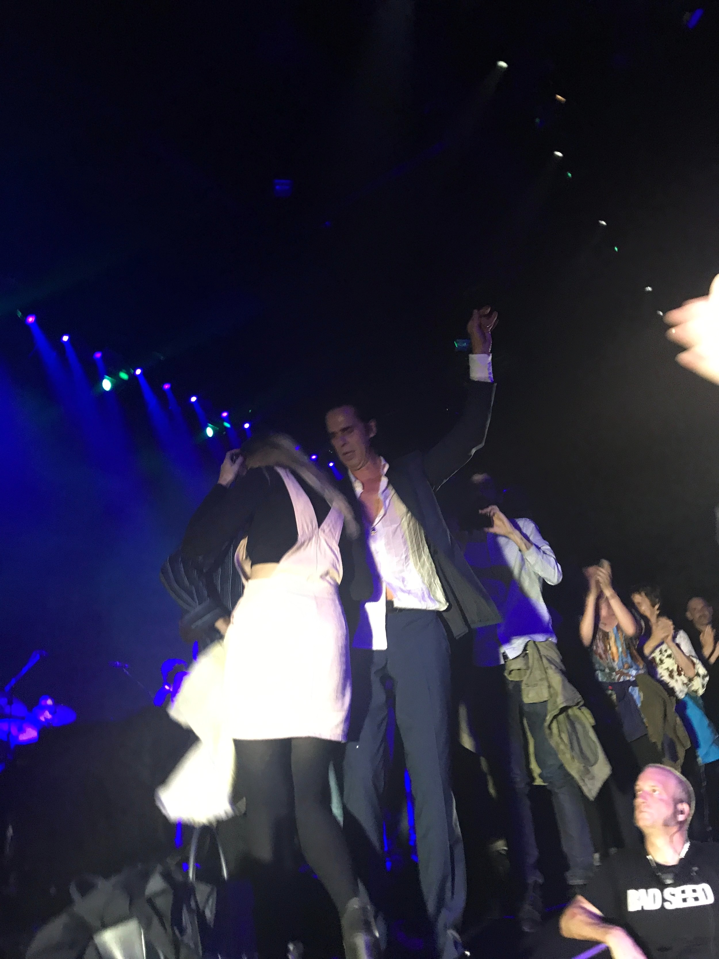 Burntaxe at Nick Cave and The Bad Seeds Skeleton Tree gig in Bournemouth BIC on 24th September 2017, woman dancing with Nick Cave during stage invasion, picture courtesy Michelle Mealor, Burntaxe