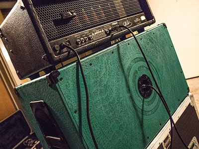 Burntaxe_Laser_Cut_Etched_Guitar_Custom_Speaker_Cabinet_Back etched in farewella design in river jumpers green with Burtnaxe target logo on back