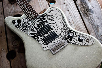 Farewella black and mirror scratchplate customised and made to order for Dazz Jaguar guitar by Burntaxe in Brighton UK