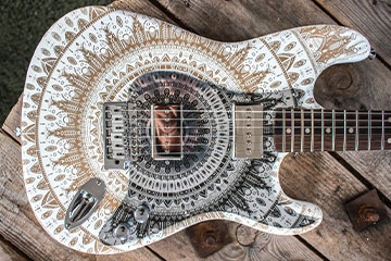 Mandy replacement scratchplate pickguard made to order for stratocaster white and cream mandala guitar using acrylic laser etched material in Black and mirror finish customised and set up by Burntaxe in Brighton England