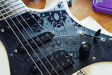 black on black 3 ply 4 ply acrylic bespoke customised replacement scratchplate pickguard fits squier fender gibson les paul epiphone balaguer strandberg electric guitars and bass made by burntaxe in Brighton England