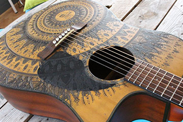 made to order replacement scratchplate pickguard for accoustic guitar made burntaxe using mandala design in black