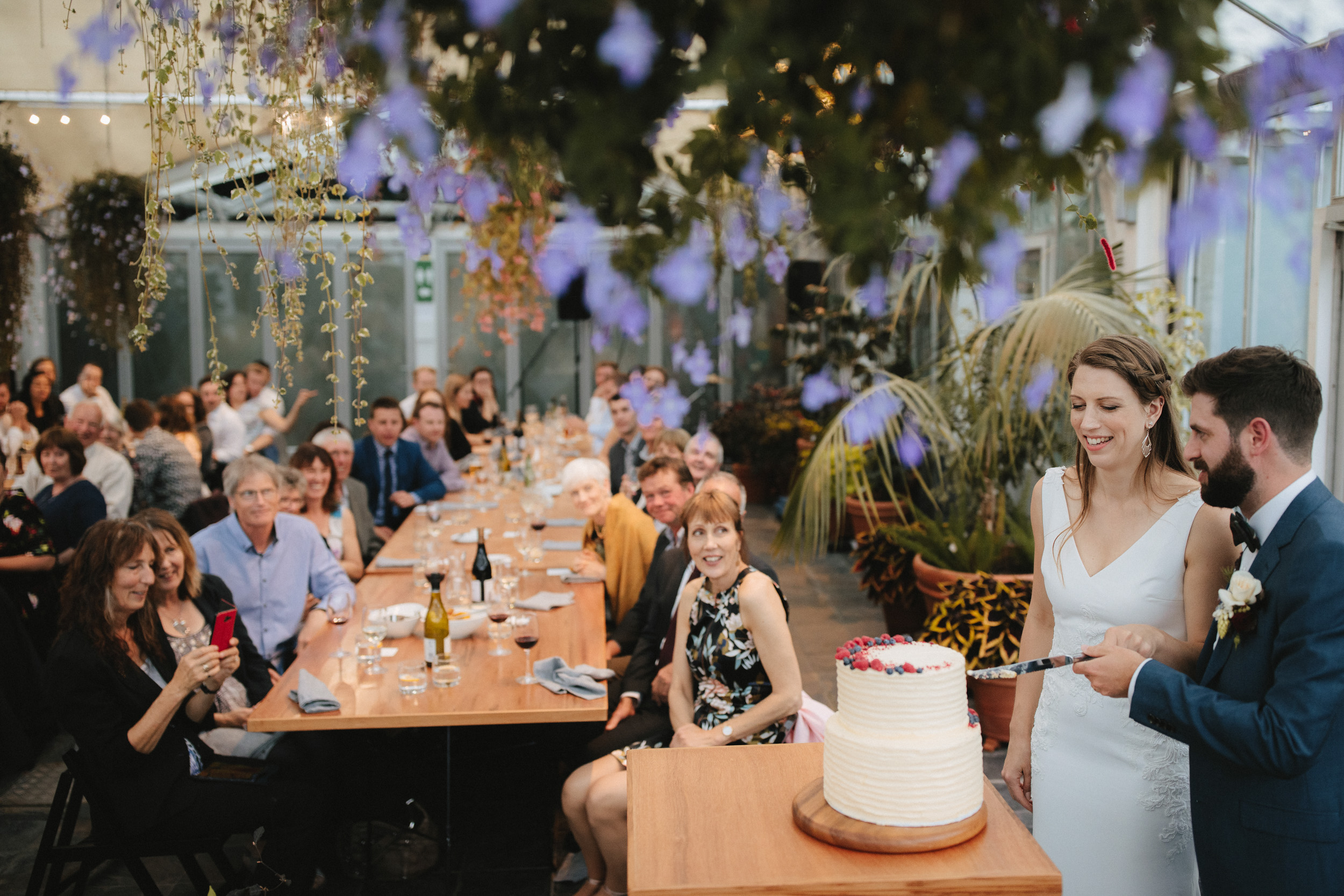 Couple cut their cake at their Botanic Garden wedding