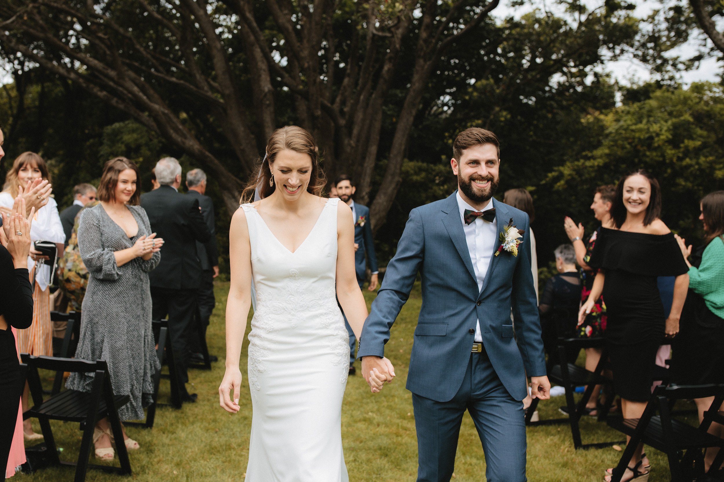 Newly married couple leave their ceremony on Magpie Lawn