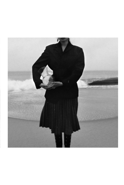 Blazer, Skirt & Belt: Maison Martin Margiela; Boots: Christian Dior; Earrings: Aglaia