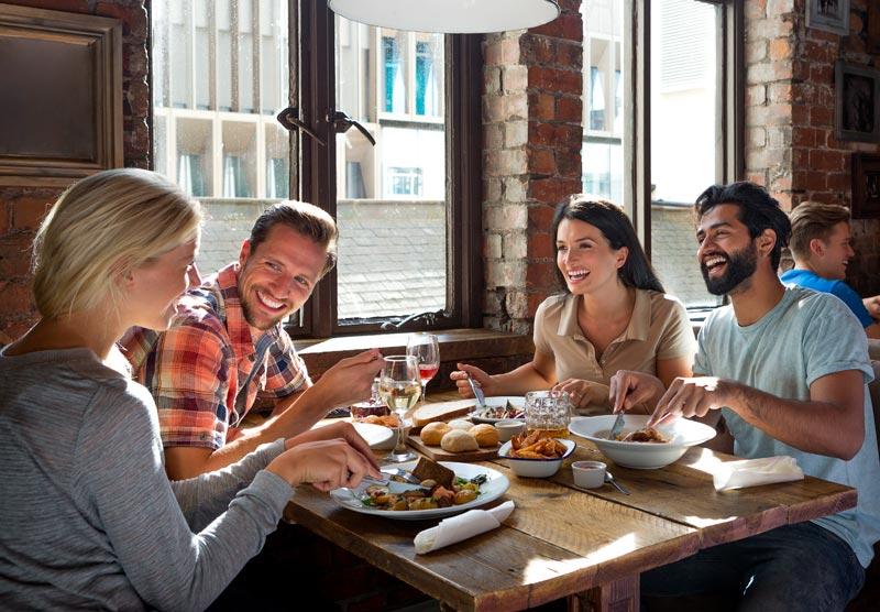Four Friends Enjoying Lunch