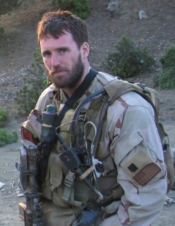 """In honor of Navy Lieutenant Michael P. Murphy, fondly referred to by friends and family as """"Murph.""""    Murphy was the leader of a four-man SEAL reconnaissance unit that secretly infiltrated into the Hindu-Kush mountains on June 27, 2005. Ambushed by overwhelming Taliban forces, Murphy valiantly climbed into the open onto high ground to make an electronic call for rescue. Wounded, he fought on, allowing one member of his squad to escape, before he himself was killed. Murphy's remains were found during a combat search and rescue operation on July 4, 2005.    Murphy is survived by his mother Maureen,his father Dan,and his brother John."""