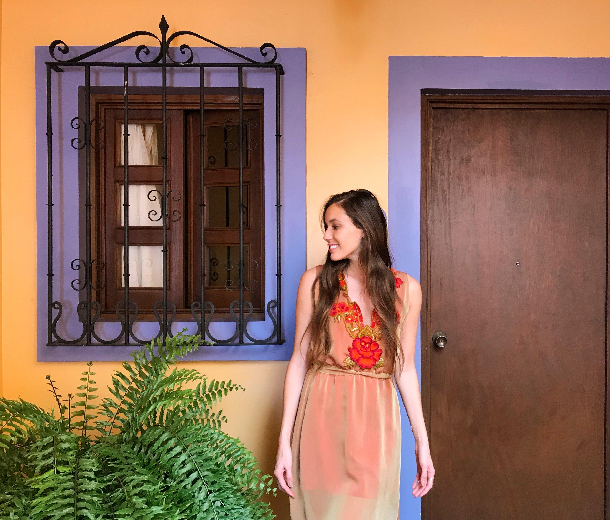 carina otero wearing an original mano madre design (which can also be worn in reverse) at hostal de la noria, oaxaca