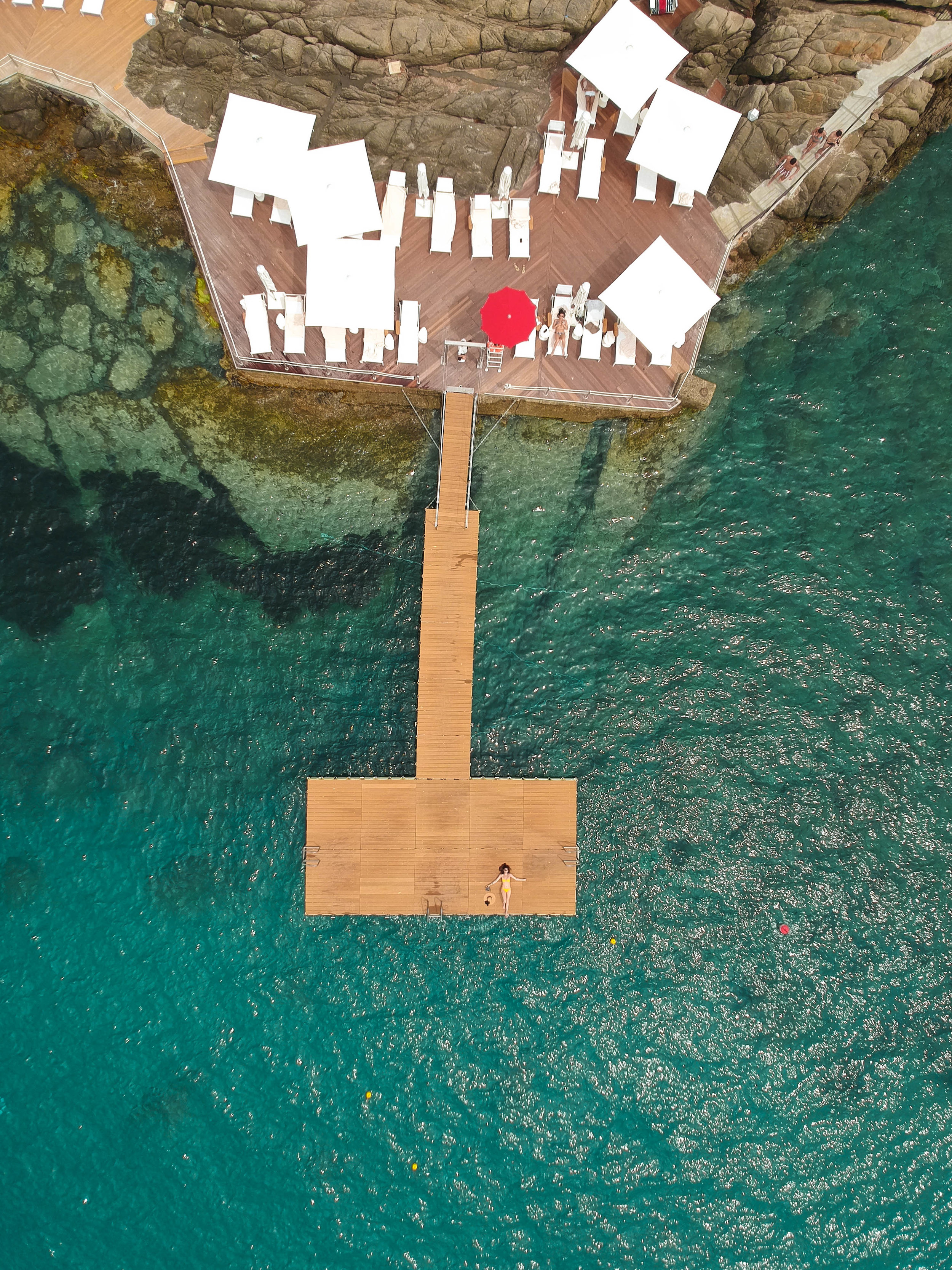 The swimming deck along the rocky coast at  Club Med Cefalù .