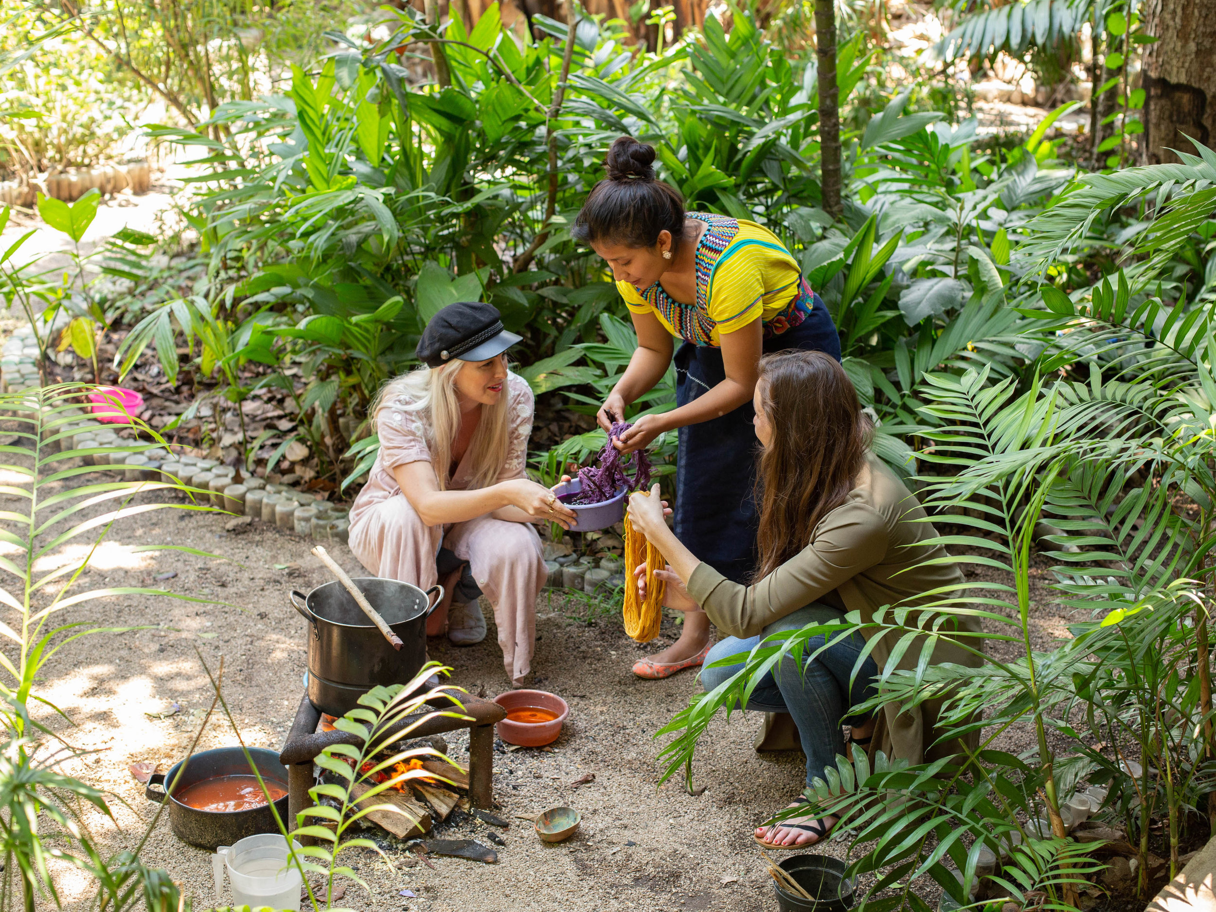 Alyssa and Carina are shown how to harvest plants to be used as all-natural dyes at a female-led textile co-op in San Juan La Laguna, Lake Atitlan, Guatemala